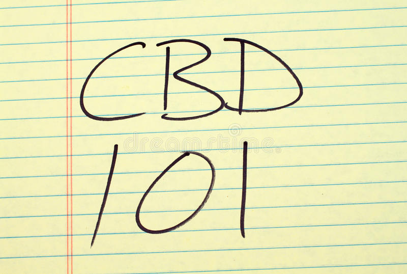 CBD 101 en un cojín legal amarillo imagen de archivo libre de regalías
