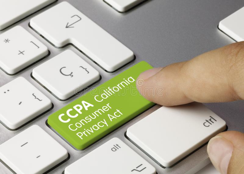 CCPA California Consumer Privacy Act - Inscription on Green Keyboard Key. CCPA California Consumer Privacy Act Written on Green Key of Metallic Keyboard. Finger stock photography