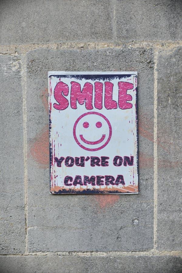 CCTV兴高采烈的面孔标志 免版税库存图片