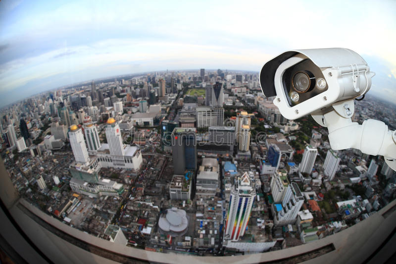 CCTV with Blur City in background fish eye perspective.  royalty free stock photos