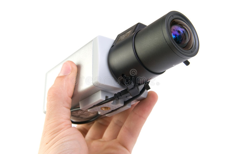 Cctv camera in hand royalty free stock images
