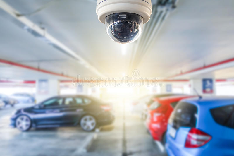 Cctv camera installed on the parking lot to protection security. In shopping mall stock photography