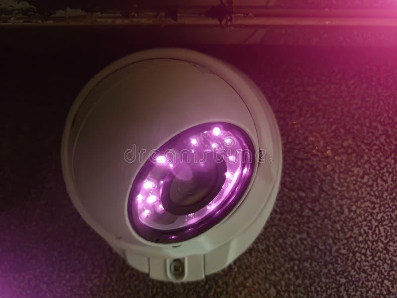 CCTV camera met verlichting in lift stock fotografie