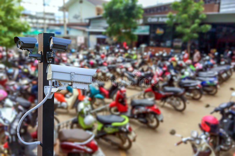 CCTV camera operating in car or motorcycle parking ,Concept Security in condo,apartment,supermarket stock photography