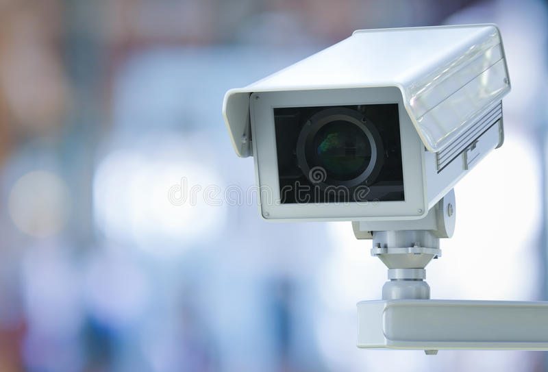 Cctv camera or security camera on retail shop blurred background. 3d rendering cctv camera or security camera on retail shop blurred background royalty free stock image