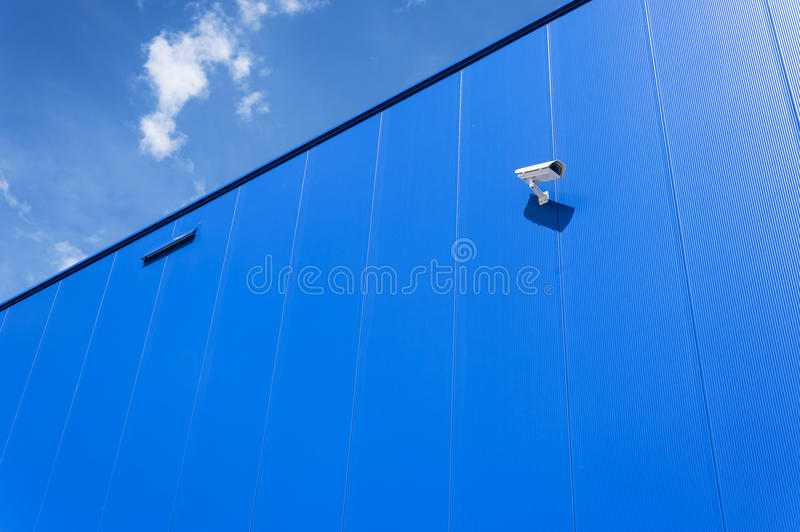 CCTV camera. Security camera on the wall. Private property protection. CCTV camera. Security camera on the blue wall. Private property protection royalty free stock photo