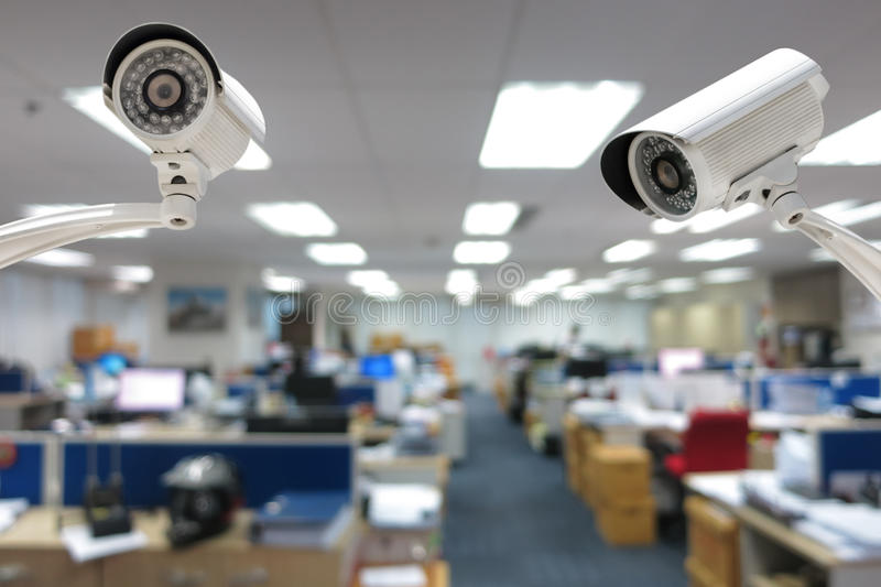 CCTV Camera security operating in office building.  stock photo