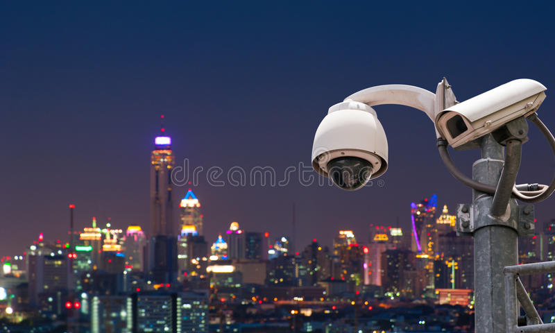 CCTV Camera. CCTV or surveillance with Blurring City in background