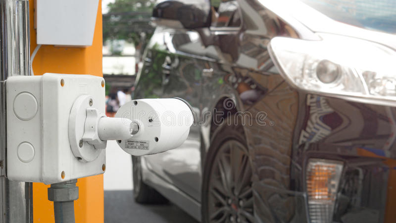 CCTV camera surveillance on car parking Safety system area control with flare light and copy space stock photos