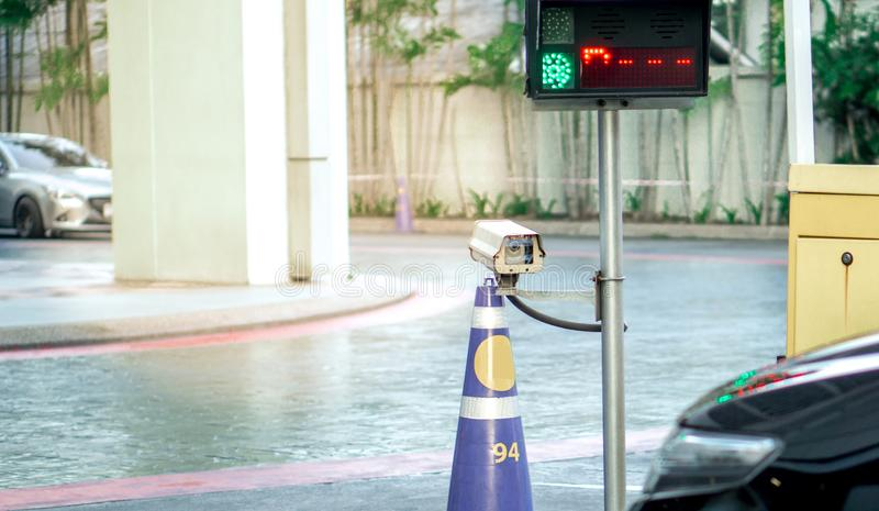 CCTV camera surveillance on car parking Safety system area control with flare light and copy space. Security equipment concept - CCTV camera surveillance on car royalty free stock photos