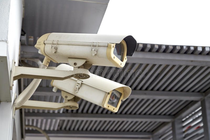 CCTV camera. Or surveillance installed on Wall royalty free stock photos