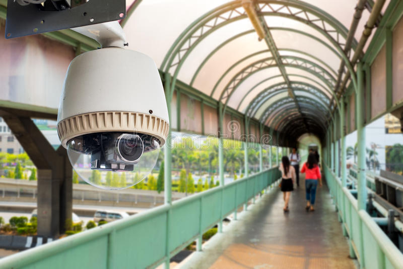 CCTV camera or surveillance operating. On walk way royalty free stock photo