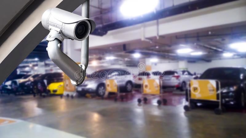 CCTV camera or surveillance system on parking. CCTV camera or surveillance system on indoor car parking stock images