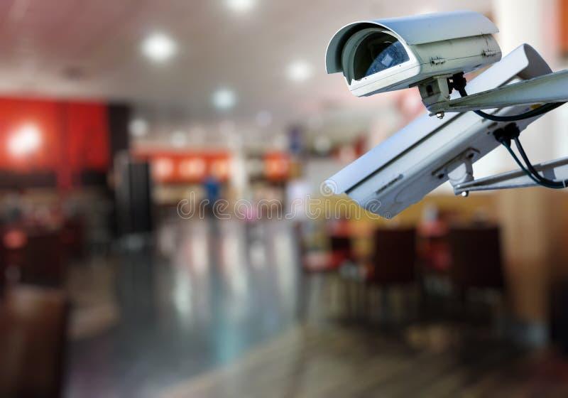 CCTV camera surveillance system restaurant. Security CCTV camera or surveillance system with restaurant on blurry background royalty free stock image