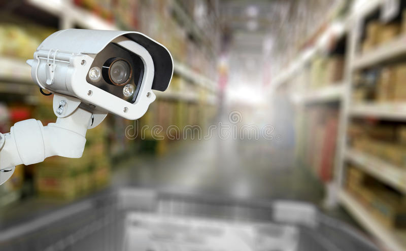 CCTV camera system security in shopping mall supermarket blur ba. Ckground stock images