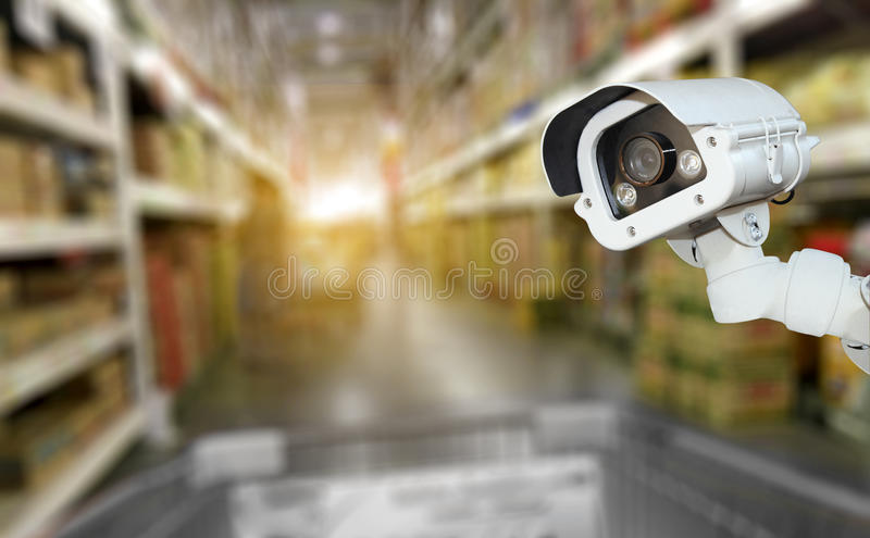 CCTV camera system security in shopping mall supermarket blur ba. Ckground royalty free stock photo