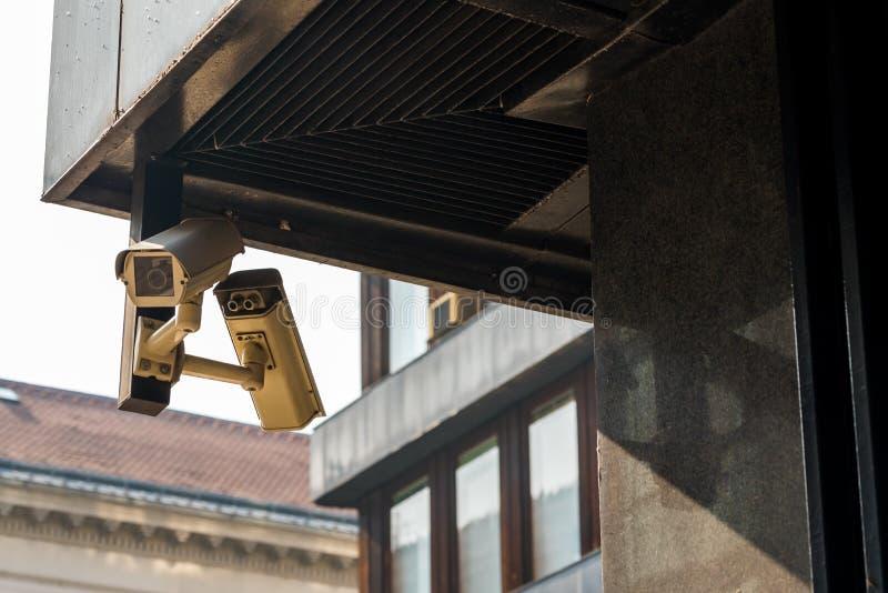 CCTV cameras on the house on the corner. CCTV cameras aimed at two sides along the house on the corner stock photos