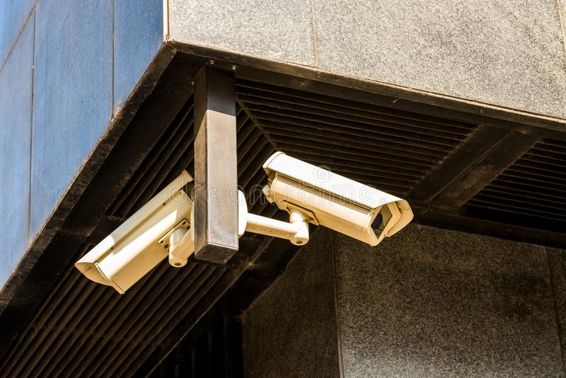 CCTV cameras on the house on the corner. CCTV cameras aimed at two sides along the house on the corner royalty free stock photography