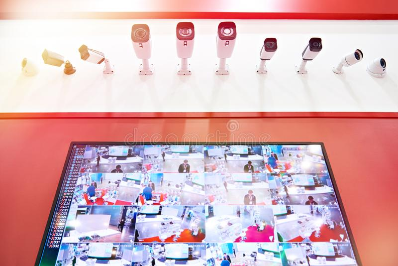 CCTV cameras and monitor. On red stock image