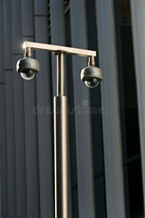CCTV cameras outside an office building royalty free stock images