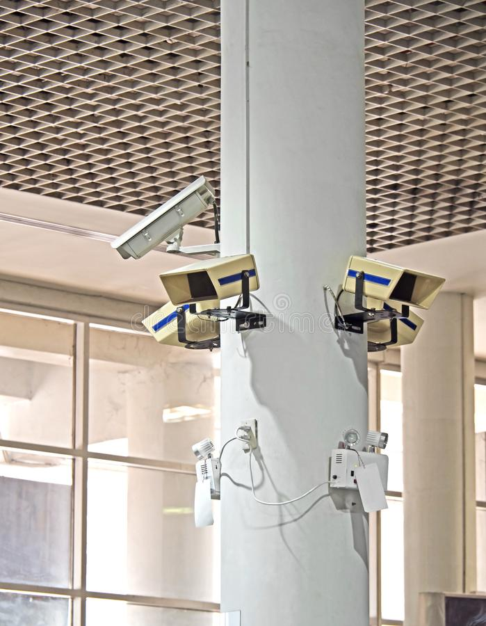 CCTV or Closed Circuit Television Camera on White Pillar stock photography