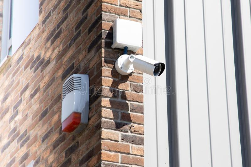 CCTV Security camera at building in city with brick wall background in Technology concept stock photo