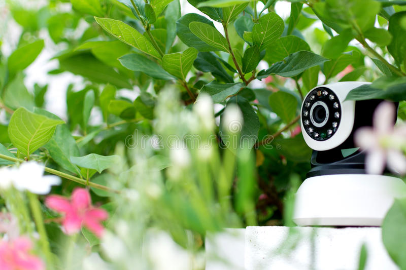 CCTV security camera operating in home. royalty free stock photography