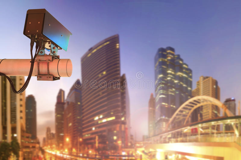 CCTV Security Camera or surveillance Operating on traffic road a. Nd urban scene in sunset royalty free stock photos