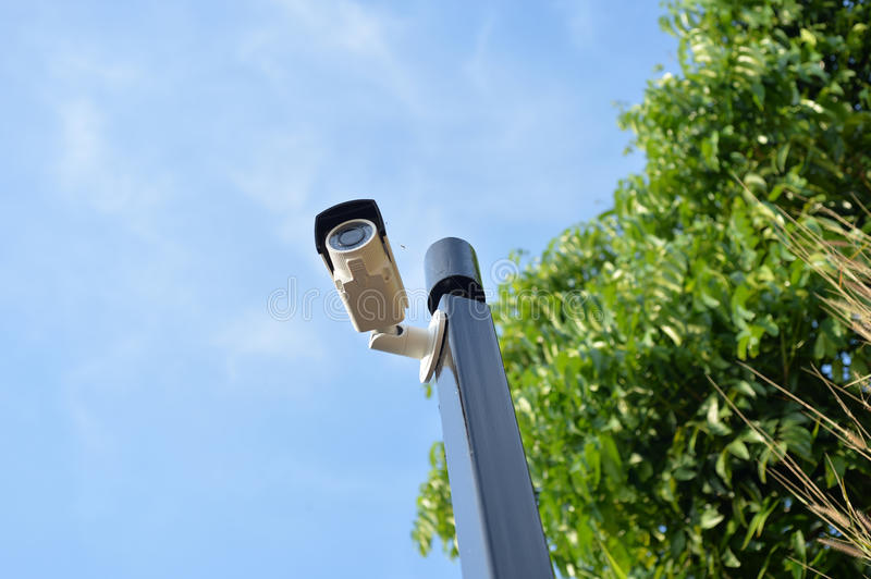 CCTV Security. Security camera and urban video on blue sky royalty free stock photography