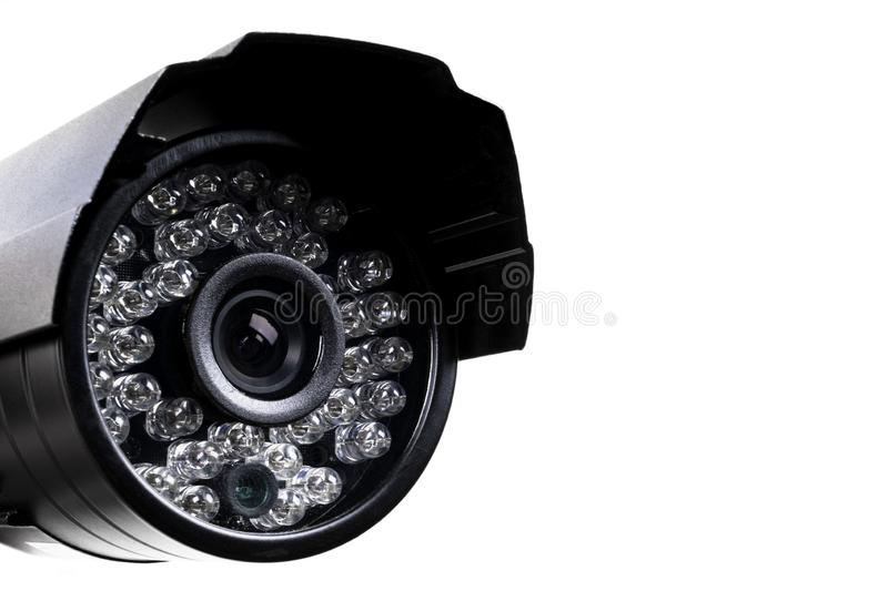 CCTV security camera video equipment. Surveillance monitoring. Video camera lens closeup. Macro shot. Security concept. Security c. Amera isolated on white stock photo