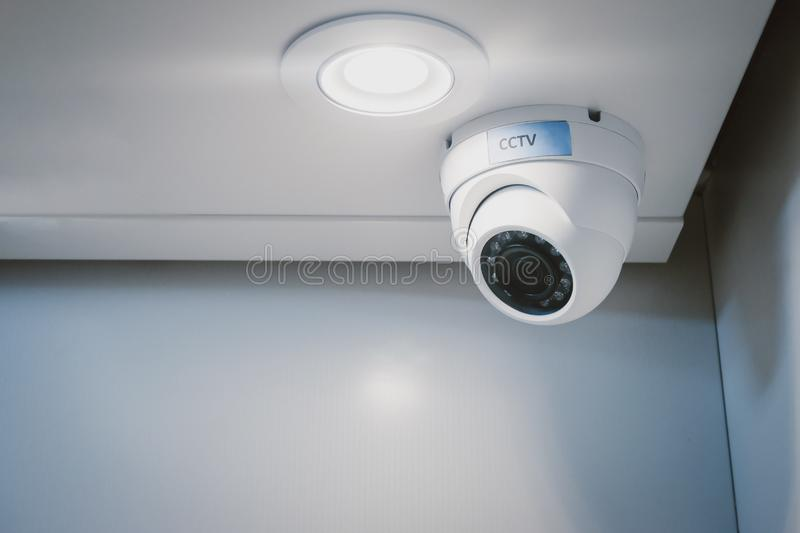 CCTV security camera on wall in the home office for surveillance monitoring home guard system. royalty free stock image