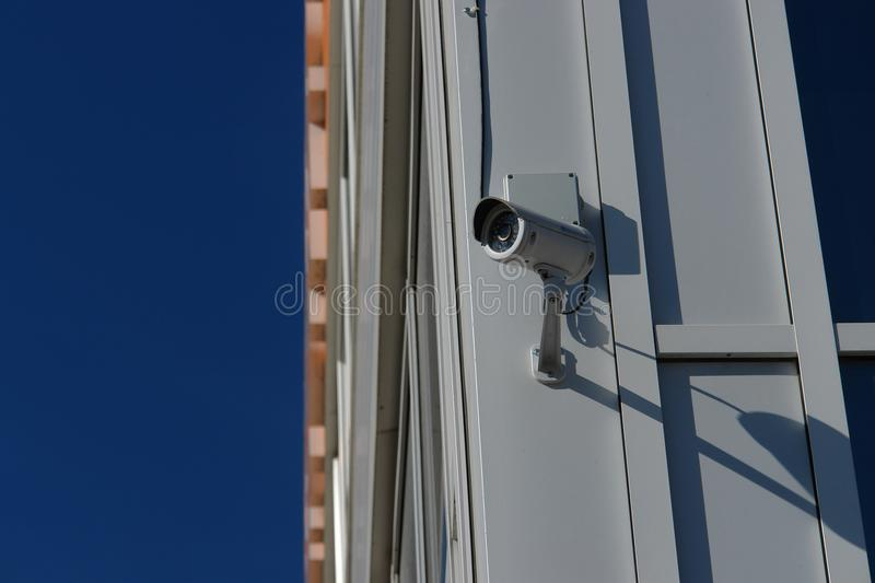 CCTV security camera on the wall outside. royalty free stock photos