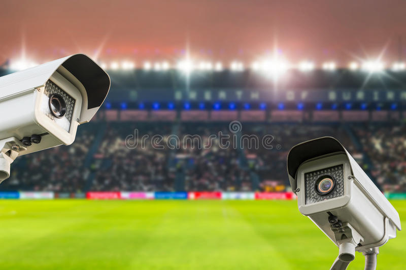 CCTV security in stadium football at twilight background. royalty free stock photos