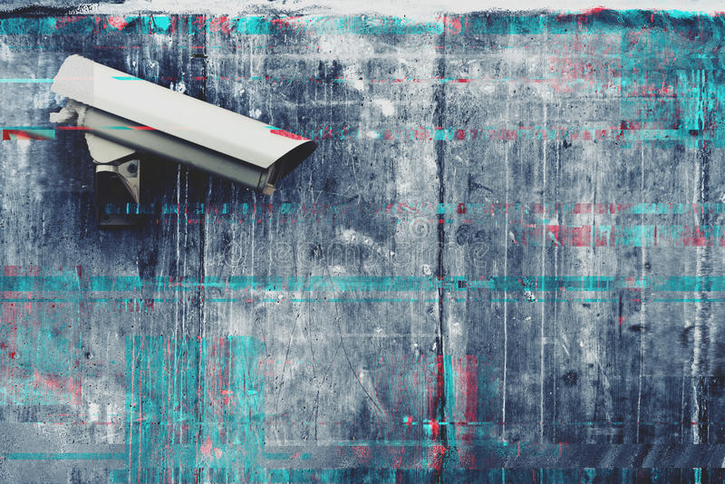 CCTV security and surveillance camera. With digital glitch effect royalty free stock images