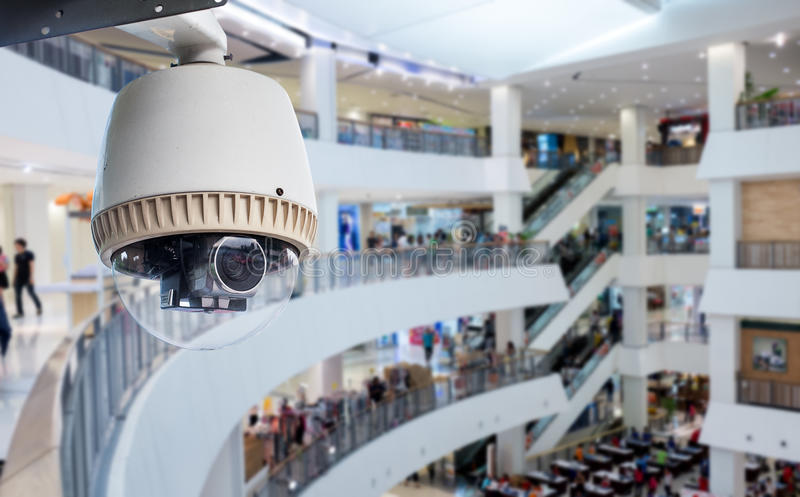 CCTV or surveillance Camera Operating. Inside department store royalty free stock photo