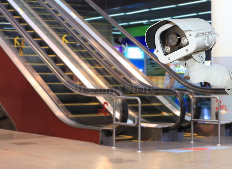 CCTV or surveillance Camera Operating inside department store.  stock image