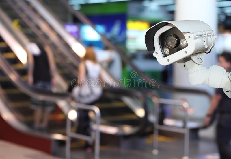 CCTV or surveillance Camera Operating inside department store.  royalty free stock images