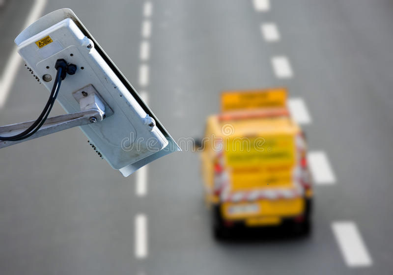CCTV system on the road. Security CCTV camera or surveillance system with road highway on blurry background stock images