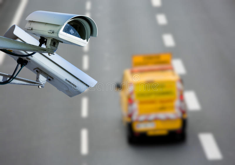 CCTV system on the road. Security CCTV camera or surveillance system with road highway on blurry background stock photos