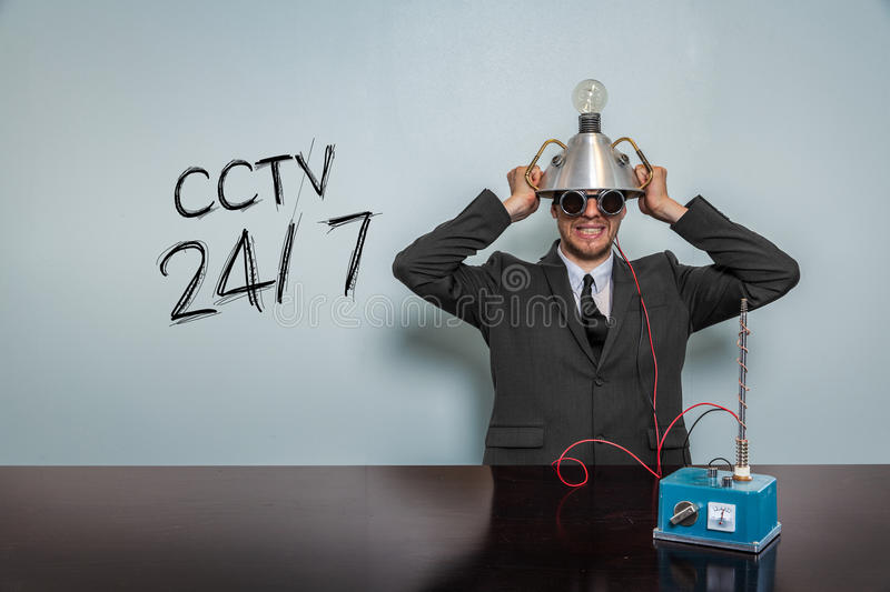 Cctv 247 text with vintage businessman. And machine at office royalty free stock photos