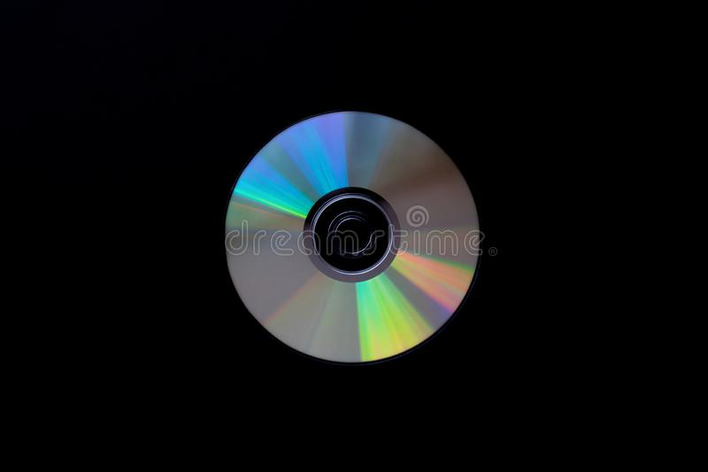 Cd compact disc on dark black background top view  with copy space. Close-up stock photography