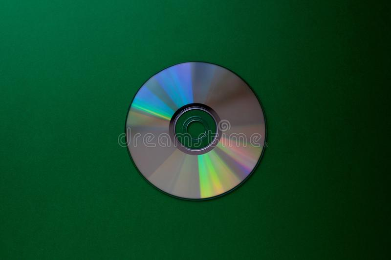 Cd compact disc on a Dark green background top view with copy space. Close-up stock images