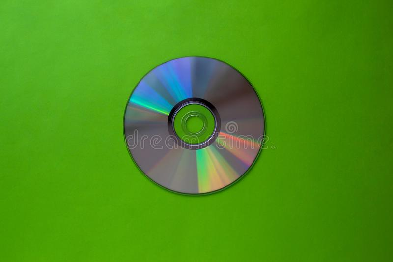 Cd compact disc on a light green background top view with copy space. Close-up stock images