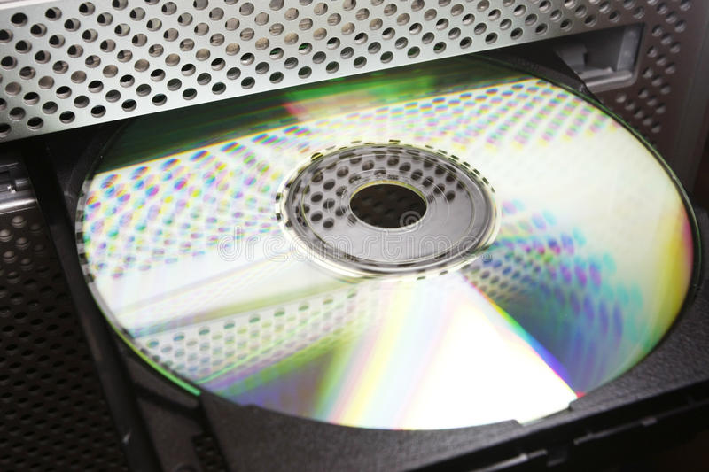 CD in computer disc drive stock images