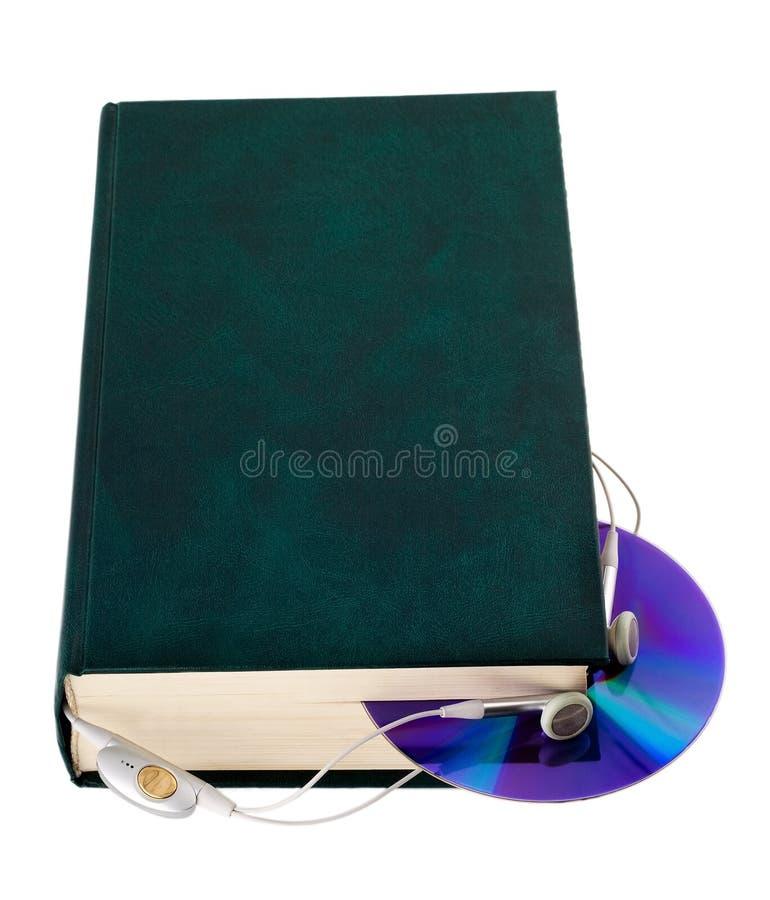 CD con los auriculares imagen de archivo libre de regalías