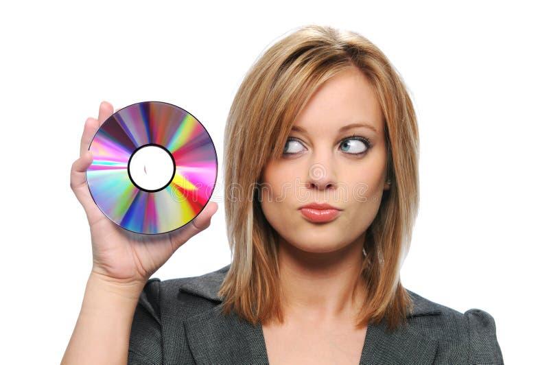 CD da terra arrendada da mulher de negócios fotografia de stock