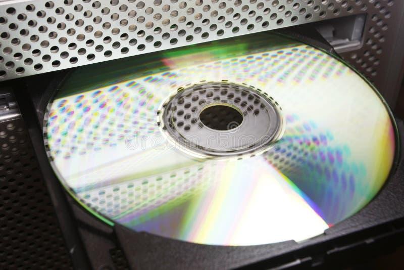 CD dans l'unité de disques d'ordinateur images stock