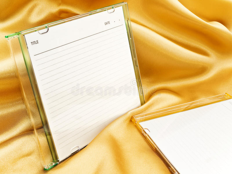 Cd disc. With blank cover over the gold background stock photo