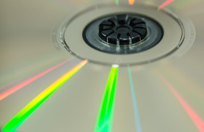 Cd disc with colorful reflection light detail macro view. Cd with colorful reflection light detail macro view stock photography