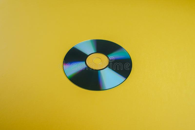 CD Disc data storage on yellow background. Close up royalty free stock image